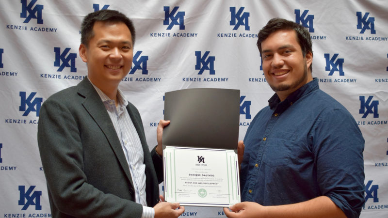 Photo of Kenzie Academy grad Enrique Galindo receiving his certification from Co-Founder and CEO Chok Ooi.