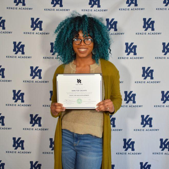 Photo of Kenzie Academy Software Engineering grad Darlyze Calixte holding her certification.